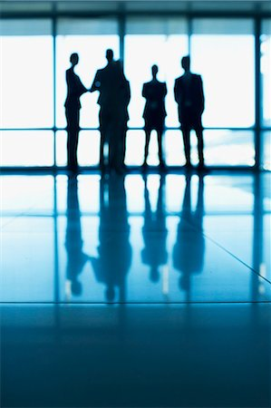 silhouettes - Silhouette of business people standing at lobby window Stock Photo - Premium Royalty-Free, Code: 635-06045039