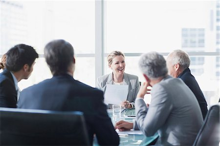 Smiling businesswoman leading meeting in conference room Stock Photo - Premium Royalty-Free, Code: 635-06045048