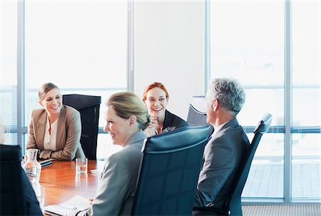 Smiling business people meeting at table in conference room Stock Photo - Premium Royalty-Free, Code: 635-06045057