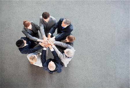 piles of work - Business people stacking hands in circle Stock Photo - Premium Royalty-Free, Code: 635-06045059