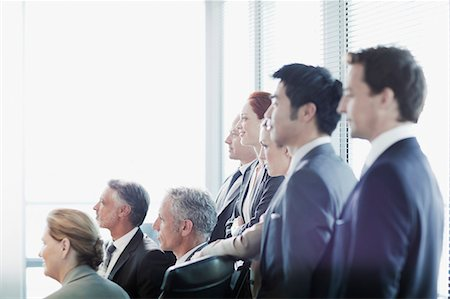 Business people watching presentation in conference room Stock Photo - Premium Royalty-Free, Code: 635-06045064
