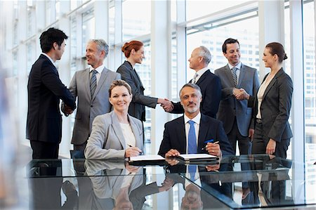 Business people shaking hands in conference room Stock Photo - Premium Royalty-Free, Code: 635-06045068