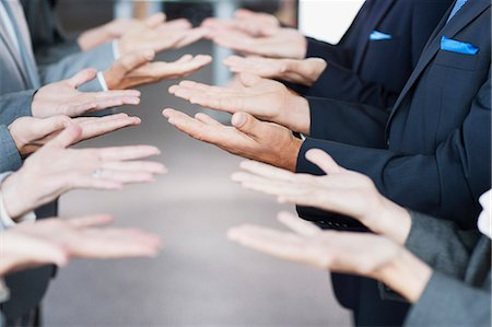 Business people standing in row with palms up Stock Photo - Premium Royalty-Free, Code: 635-06045060