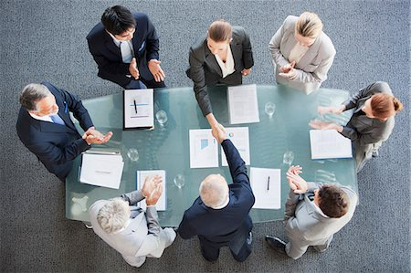 Business people shaking hands across conference room table Stock Photo - Premium Royalty-Free, Code: 635-06045074