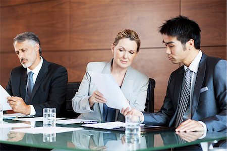 partnership - Businesswoman showing paperwork to businessman in meeting Stock Photo - Premium Royalty-Free, Code: 635-06045077
