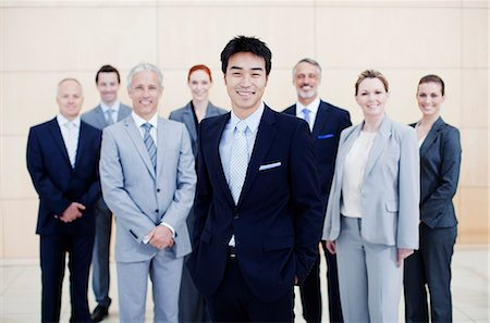 Portrait of smiling business people Stock Photo - Premium Royalty-Free, Code: 635-06045087