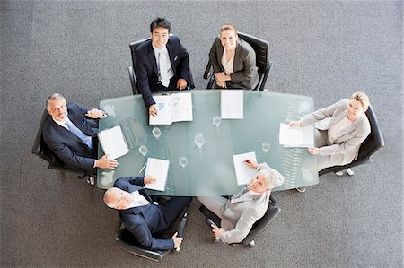 Portrait of smiling business people at table in conference room Stock Photo - Premium Royalty-Free, Code: 635-06045097