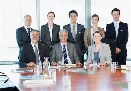 Portrait of smiling business people in conference room Stock Photo - Premium Royalty-Free, Code: 635-06045098