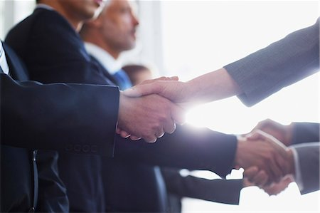Close up of business people shaking hands in a row Stock Photo - Premium Royalty-Free, Code: 635-06045103