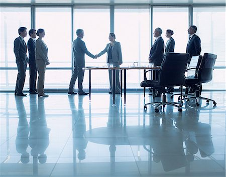 Business people shaking hands in conference room Stock Photo - Premium Royalty-Free, Code: 635-06045115
