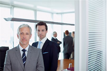 Portrait of confident businessman in doorway of conference room Stock Photo - Premium Royalty-Free, Code: 635-06045118