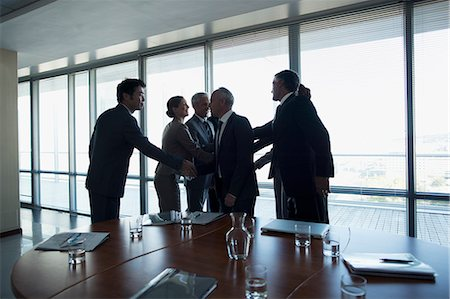 Business people shaking hands in conference room Stock Photo - Premium Royalty-Free, Code: 635-06045110