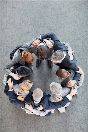 partnership - Business people in huddle Stock Photo - Premium Royalty-Free, Code: 635-06045112