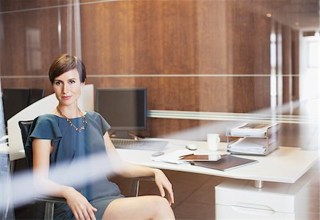 short hair - Portrait of confident businesswoman sitting at desk in office Stock Photo - Premium Royalty-Free, Code: 635-06045133
