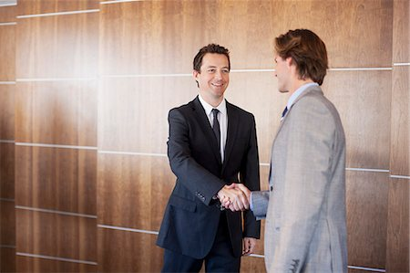 Smiling businessmen shaking hands Stock Photo - Premium Royalty-Free, Code: 635-06045149