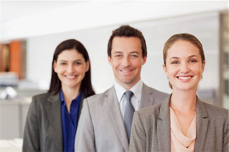 Portrait of smiling business people Stock Photo - Premium Royalty-Free, Code: 635-06045153