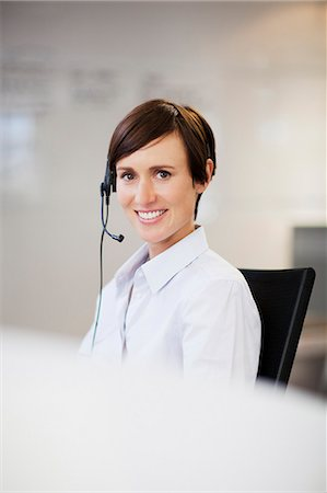 short hair - Portrait of smiling businesswoman wearing headset Stock Photo - Premium Royalty-Free, Code: 635-06045186