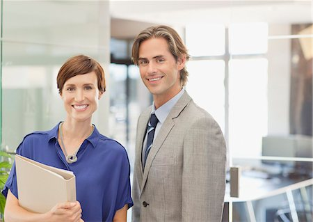 Portrait of smiling business people in office Stock Photo - Premium Royalty-Free, Code: 635-06045180