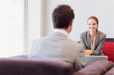 Business people talking face to face in lobby Stock Photo - Premium Royalty-Free, Code: 635-06045182