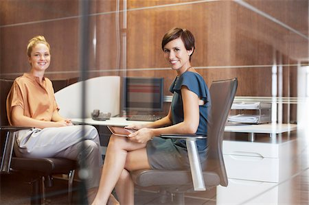 Portrait of smiling businesswomen in office Stock Photo - Premium Royalty-Free, Code: 635-06045199