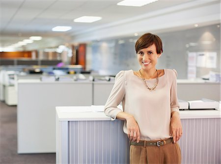 short hair - Portrait of smiling businesswoman in office Stock Photo - Premium Royalty-Free, Code: 635-06045208