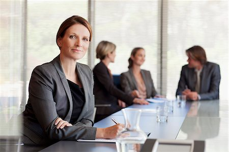 Portrait of confident businesswoman in conference room Stock Photo - Premium Royalty-Free, Code: 635-06045221