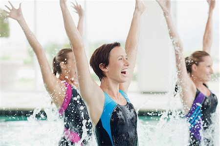 Enthusiastic women jumping in swimming pool Stock Photo - Premium Royalty-Free, Code: 635-06045235