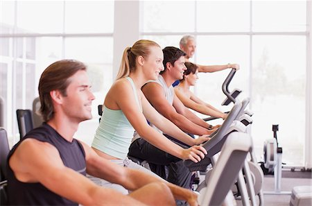 People working out on exercise machines in gymnasium Stock Photo - Premium Royalty-Free, Code: 635-06045246
