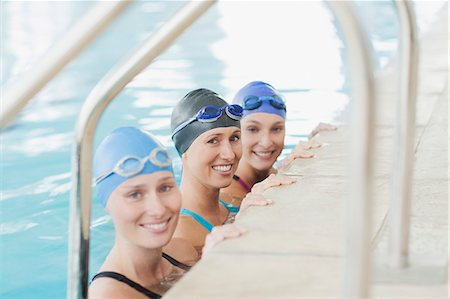 swimming - Portrait of smiling women at edge of swimming pool Stock Photo - Premium Royalty-Free, Code: 635-06045328