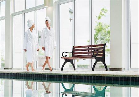 swimming pool water - Women in bathrobes walking along swimming pool at spa Stock Photo - Premium Royalty-Free, Code: 635-06045359