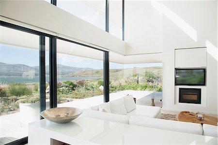 Living room overlooking lake Stock Photo - Premium Royalty-Free, Code: 635-06045454