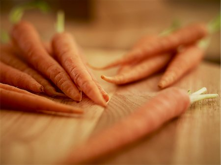 Close up of carrots on cutting board Stock Photo - Premium Royalty-Free, Code: 635-06045536