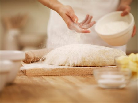 Woman dusting dough with flour Stock Photo - Premium Royalty-Free, Code: 635-06045540