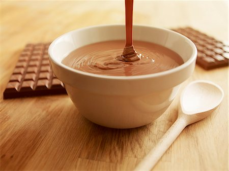 Melted chocolate pouring into bowl Stock Photo - Premium Royalty-Free, Code: 635-06045556