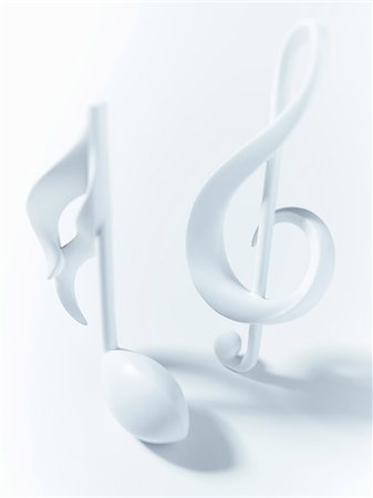Close up of semiquaver and treble clef musical notes on white background Stock Photo - Premium Royalty-Free, Code: 635-06045575