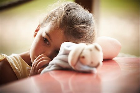sucking - Close up of girl with stuffed animal sucking thumb Stock Photo - Premium Royalty-Free, Code: 635-06045572