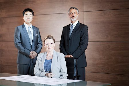 Portrait of confident business people in conference room Stock Photo - Premium Royalty-Free, Code: 635-06045583