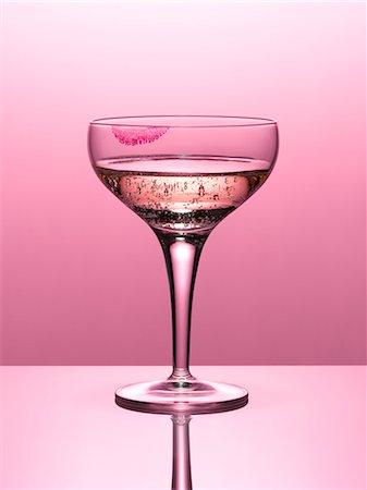 Close up of pink champagne in glass with lipstick stain Stock Photo - Premium Royalty-Free, Code: 635-06045597