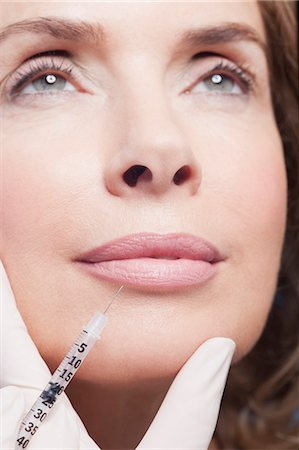 Close up of woman receiving botox injection Stock Photo - Premium Royalty-Free, Code: 635-06045624