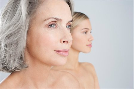 Close up of bare chested mother and daughter Stock Photo - Premium Royalty-Free, Code: 635-06045627