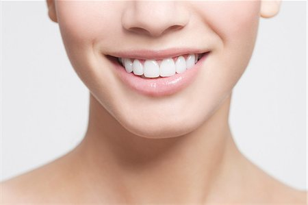 Close up of smiling woman's mouth Stock Photo - Premium Royalty-Free, Code: 635-06045683