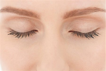 Close up of woman's closed eyes Stock Photo - Premium Royalty-Free, Code: 635-06191514
