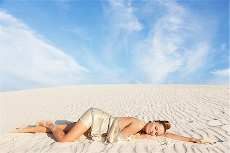 desert people dress photos - Serene woman laying on white sand beach Stock Photo - Premium Royalty-Free, Code: 635-06191555
