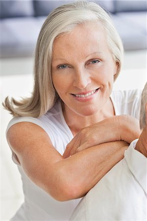 Close up portrait of smiling woman leaning on man's shoulder Stock Photo - Premium Royalty-Free, Code: 635-06191581