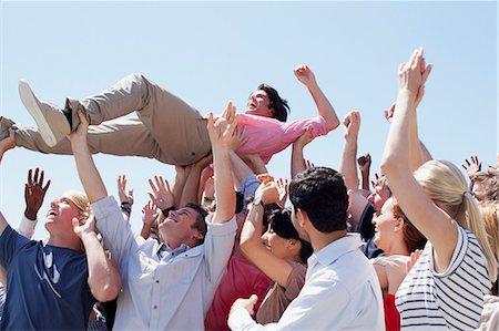 Man crowd surfing Stock Photo - Premium Royalty-Free, Code: 635-06191669