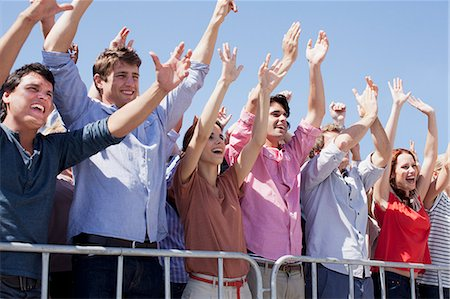 Cheering crowd with arms raised Stock Photo - Premium Royalty-Free, Code: 635-06191678