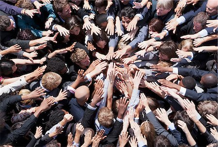 standing - Crowd of business people extending hands in huddle Stock Photo - Premium Royalty-Free, Code: 635-06191670