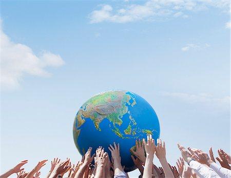 Crowd reaching for globe Stock Photo - Premium Royalty-Free, Code: 635-06191683