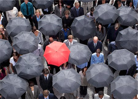 Red umbrella standing out in crowd of business people Stock Photo - Premium Royalty-Free, Code: 635-06191697