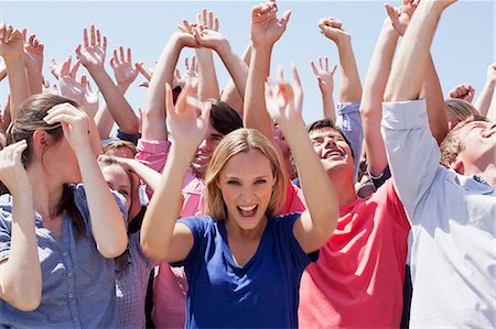 Cheering crowd with arms raised Stock Photo - Premium Royalty-Free, Code: 635-06191704